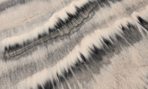 The dark sand and sparkling mica make interesting patterns when the waves recede